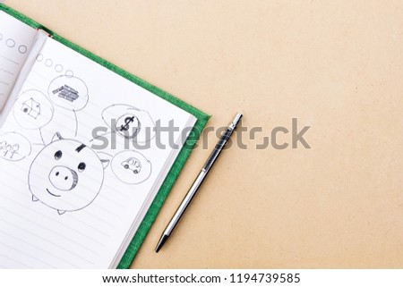 Drawn sketchy piggy bank and money related icons on lined notebook paper background. Save and investment money for prepare in the future - concept of saving money. #1194739585