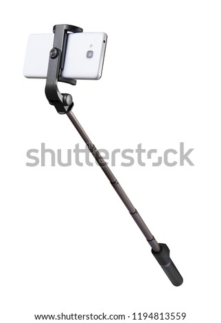 Selfie stick monopod and cellphone isolated on white with clipping path Royalty-Free Stock Photo #1194813559