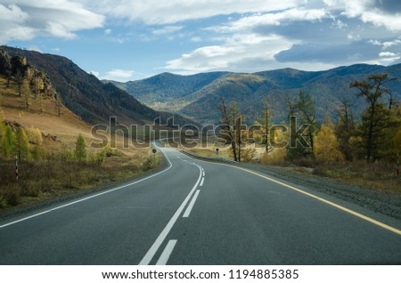 Autumn road in the mountains #1194885385