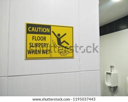 Wet floor caution sign in the toilet.  #1195037443
