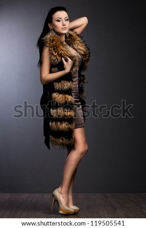 beautiful fashionable woman in fur #119505541