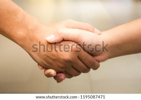 Informal shake hand #1195087471