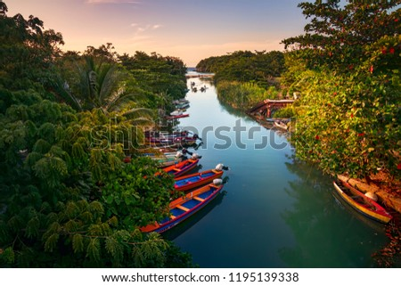 Fishermen boats docked on the White River in St Ann, Jamaica. #1195139338