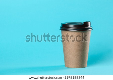 Takeaway paper coffee cup mockup isolated on blue background. Concept photo of coffee cup. Free empty blank copy space for your design text or banner of brand. Trending colors #1195188346