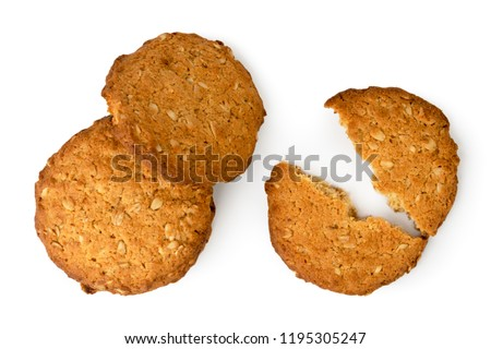 Oatmeal cookies broken in half on a white background. The view top. #1195305247