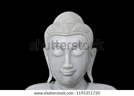 statue of Buddha detail face with black background #1195351720