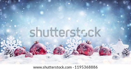 Christmas - Red Baubles Decorated And Snowflakes In Snowing Background   Royalty-Free Stock Photo #1195368886