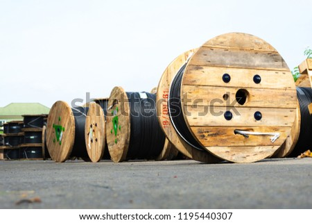Wooden Coils Of Electric Cable Outdoor. High and low voltage cables in the storage. #1195440307