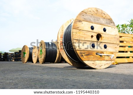 Wooden Coils Of Electric Cable Outdoor. High and low voltage cables in the storage. #1195440310