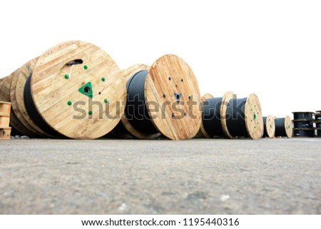 Wooden Coils Of Electric Cable Outdoor. High and low voltage cables in the storage. #1195440316
