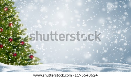 decorated fir tree in snowy landscape #1195543624