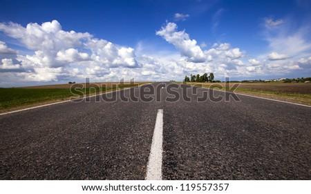 the highway - the asphalted highway in summertime of year. Belarus #119557357