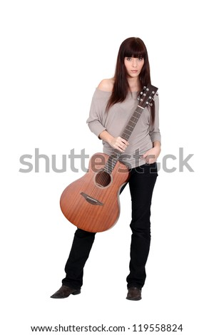 Woman posing with her guitar #119558824
