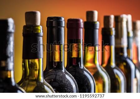 Line of wine bottles. Close-up. #1195592737
