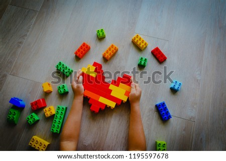 child play with colorful plastic blocks, learning activities for kids #1195597678