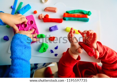 kids play with clay molding shapes, learning through play #1195597735