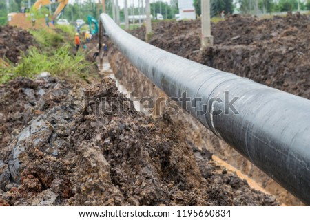 Construction of Oil Pipeline,pipeline transportation ,Construction work on the pipe laying of the pipelines in a special corrosion-resistant insulation in the trench on the soil. #1195660834