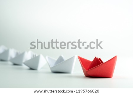 Red paper ship leading among white on white background. Success and Leadership concept #1195766020