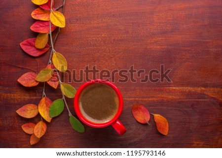Red cup of coffee and colorful autumn leaves on the wooden table. Top view. #1195793146