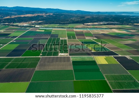 Pacific coast of California with farmland close to the cities of Salinas and Monterey. The picture was taken in the early July. Royalty-Free Stock Photo #1195835377