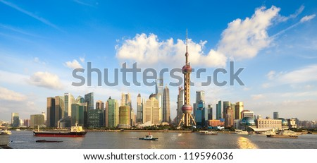 panoramic view of shanghai skyline with huangpu river at dusk