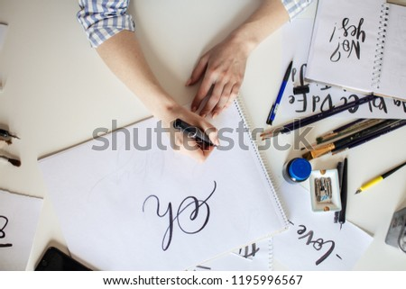 High angle view of Woman hands writing Oh words on white paper #1195996567