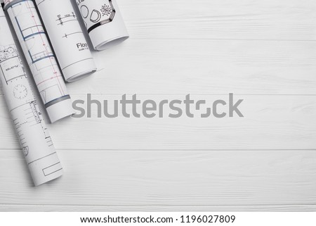 Architect worplace top view. Architectural project, blueprints, blueprint rolls on wooden desk table. Construction background. Engineering tools. Copy space Royalty-Free Stock Photo #1196027809