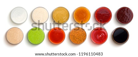 Set of different sauces isolated on white background, top view #1196110483