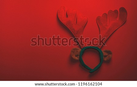 Christmas antlers on red background, Holiday Banner Greeting Card Winter Xmas Background Happy New Year Theme Copy Space for Text