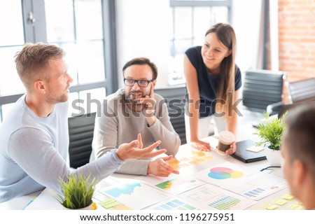 Business people meeting at office and use post it notes to share idea. Brainstorming concept. Sticky note on glass wall. #1196275951