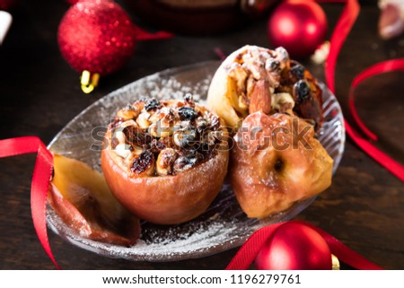 Fruit dessert baked red apples stuffed with granola #1196279761