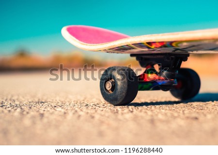 Skateboard on the road close up