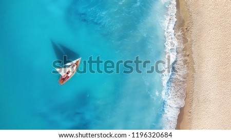 Yacht on the water surface from top view. Turquoise water background from top view. Summer seascape from air. Travel concept and idea #1196320684