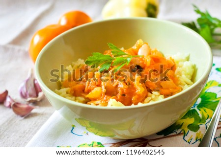 Steamed rice with stewed vegetables and turmeric #1196402545