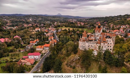 Aerial view of Bran castle in beautiful Transylvania, region of Romania. Cloudy day with dark clouds #1196430100
