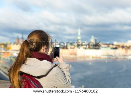 Happy travelling woman take a shot on her phone #1196480182