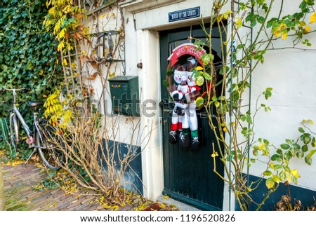 Hoorn, The Netherlands - December 11, 2009: Door decorated of cute Christmas snowmen. #1196520826
