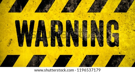 WARNING danger sign word text as stencil with yellow and black stripes painted over concrete wall cement texture wide banner background. Concept image for caution, dangerous area and hazard. Royalty-Free Stock Photo #1196537179