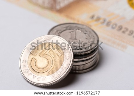Polish zlotys on white background close up #1196572177