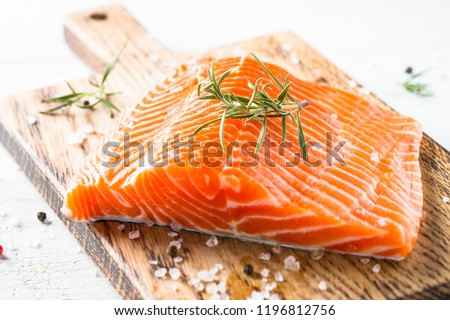 Salmon fish. Uncooked salmon fillet with lemon sea salt and rosemary on white. Close up. #1196812756