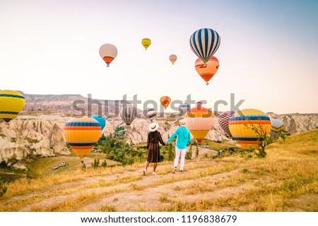 Turkey balloons Cappadocia Goreme Kapadokya , Sunrise in the mountains of Capadocia, young couple sunrise #1196838679