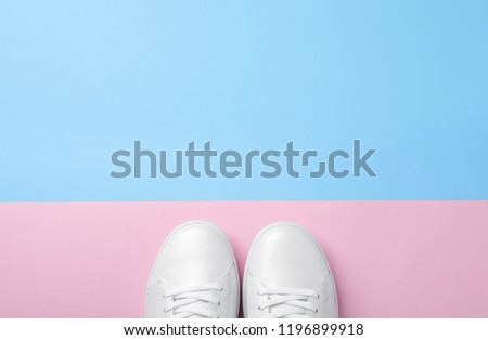 Pair of sneakers on color background, flat lay. Space for text #1196899918