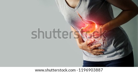 Woman touching stomach painful suffering from stomachache causes of menstruation period, gastric ulcer, appendicitis or gastrointestinal system disease. Healthcare and health insurance concept. #1196903887