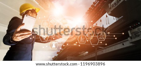 A futuristic architect, Businessman, Industry 4.0. Engineer manager using  mobile smartphone with icon network connection in construction site, Industrial and innovation. Industry technology concept. #1196903896