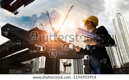 A futuristic architect, Businessman, Industry 4.0. Engineer manager using tablet with icon network connection in construction site, Industrial and innovation. Industry technology concept. #1196903914