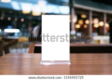 Menu frame standing on wood table in Bar restaurant cafe. space for text marketing promotion