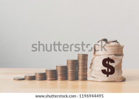 Coins in money bag with coin stack step growing growth saving money, Concept finance business investment #1196944495