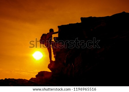 Sporty woman climbing on the cliff. Success and goal concept. Strong and healthy for outdoor activity. Fresh start of day #1196965516