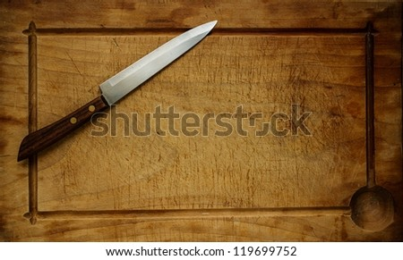 Knife on wooden background #119699752