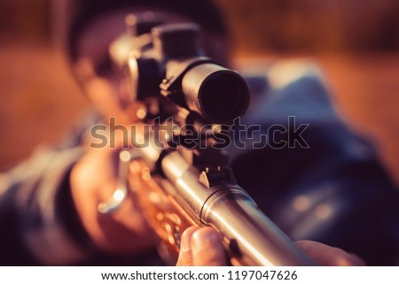 Illegal Hunting Poacher in the Forest. Hunter with shotgun gun on hunt. Hunter aiming rifle in forest. Track down #1197047626